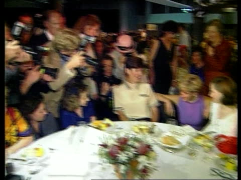 diana continues visit; int tlms side diana along thru crowd lms diana sitting chatting to young girl lms press photographers l-r to diana chatting to... - fotograf stock-videos und b-roll-filmmaterial