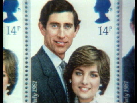 queen denies pressure lib sheet of stamps commemorating wedding of prince charles and lady diana - souvenir stock videos and b-roll footage