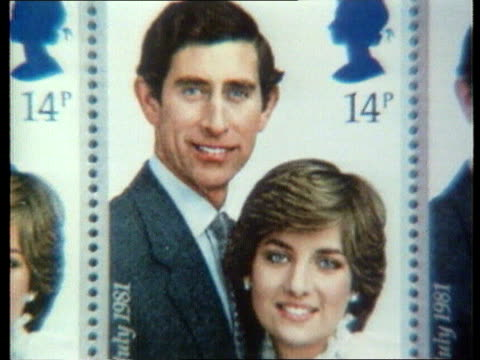 diana funeral queen denies pressure sheet of stamps commemorating wedding of prince charles and lady diana - souvenir stock videos and b-roll footage