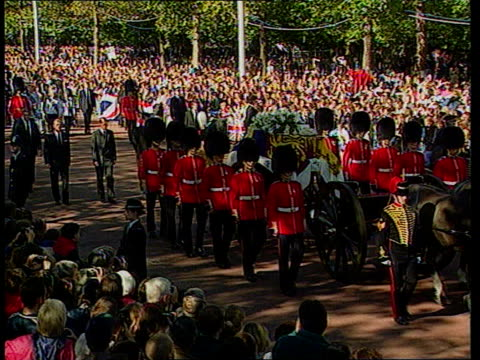Queen denies pressure U06099702 Westminster Abbey Procession along Chief mourners walk behind coffin