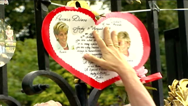 diana, princess of wales: 10th anniversary of death: did britain change?; england: london: kensington palace: ext palace gates covered with tributes... - tribute event stock videos & royalty-free footage