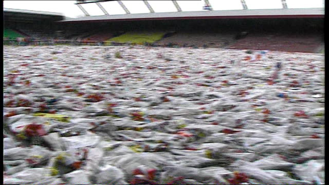 diana, princess of wales: 10th anniversary of death: did britain change?; tx 24.4.89 liverpool: anfield: carpet of flowers on pitch at anfield... - anniversary stock videos & royalty-free footage