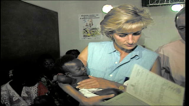 10th anniversary of death memories File January 1997 ANGOLA Luanda INT Diana holding small baby during visit to Red cross centre