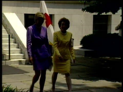 diana princess of wales and elizabeth dole president of american red cross walk side by side in brightly coloured suits to function washington; 17... - american red cross stock videos & royalty-free footage