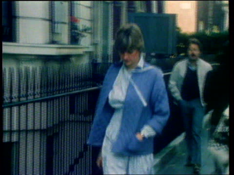 Diana Princess of Wales Collection 106956 London Kensington Princess Diana walking in street wearing pale blue jacket Diana down steps wearing blue...