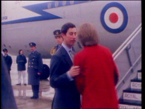 diana princess of wales collection 109003 princess diana wearing red coat bidding farewell to charles as he boards raf plane diana watching as plane... - candid stock videos & royalty-free footage