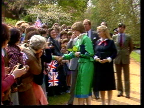 Diana Princess of Wales Collection 110145 Broadlands Charles and Diana in prewedding walkabout shaking hands with crowds lining path planting tree...