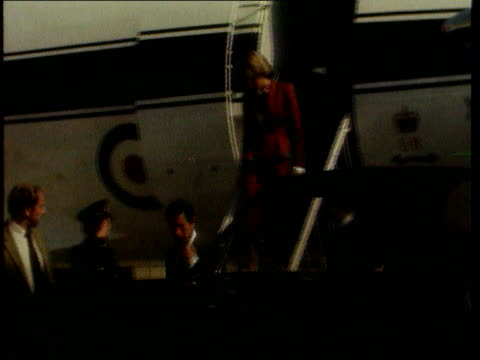 Part 4 391982 Unused Charles and Diana arrive at Heathrow Airport / Plane taxing along runway / Charles and Diana along down steps then into car