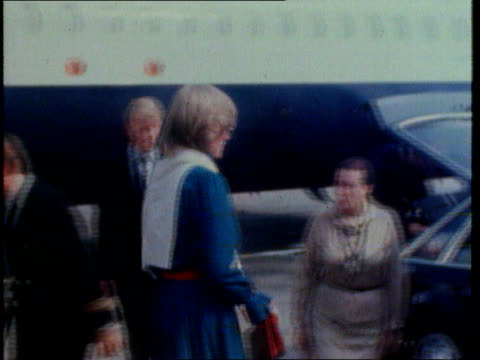 stockvideo's en b-roll-footage met part 4 tx diana wearing blue dress and red belt down plane steps and into car - 1981