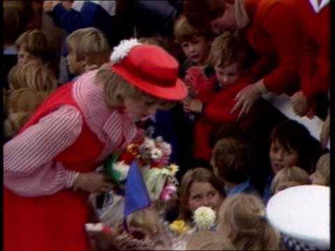 vídeos de stock e filmes b-roll de part 5 119819 australian tour australia tasmania hobart diana princess of wales in red hat and dress with large bow round neck taking gifts from... - 1983
