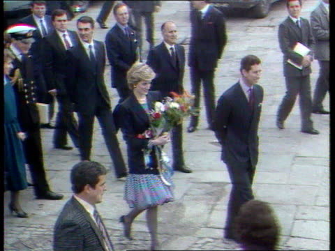 part 5 141021 portugal visit portugal oporto top shot of diana in navy blue jacket and puffball skirt carrying flowers walking with prince charles - porto district portugal stock videos & royalty-free footage