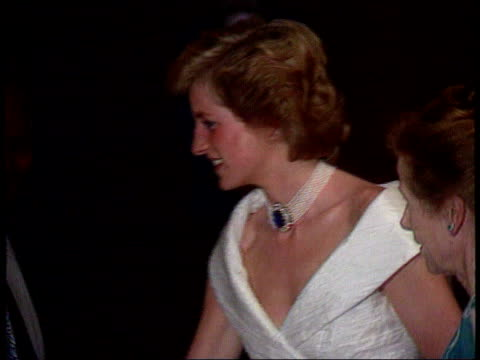Part 5 INJ1647D Diana Location unknown Close side view of Diana in white evening dress with large pearl choker and gemstone clasp Right to left and...
