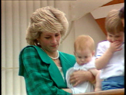 Part 5 INJ2585 All the family visit Italy ITALY Venice On board 'Britannia' Diana in green holding baby Harry pull out to Prince Charles holding...