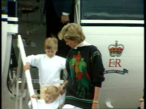 part 5 inj3757 diana and her children arrive for family holiday in scotland scotland aberdeen airport diana off plane in jumper featuring horses and... - aberdeen scotland stock videos & royalty-free footage