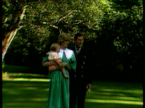 Part 5 INJ792 Prince Charles Diana Prince William photocall in garden Diana in green and white dress holding William standing alongside Prince...