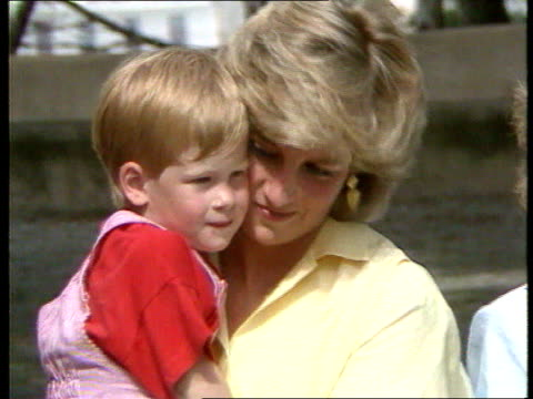 part 5 s04099701 prince and princess of wales and family visit the spanish royal family for a holiday spain majorca close shot of diana in yellow... - cheek to cheek stock videos & royalty-free footage