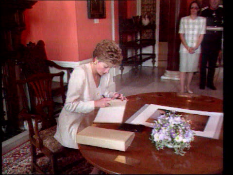 Part 5 SPL0627 Diana On Her Own Princess Diana signs book Location unknown Diana in white suit sat signing book