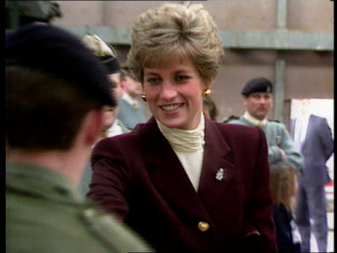 part 5 spl0628 tears of a princess princess diana with gulf war troops location unknown diana in maroon outfit talking to troops at time of 1991 gulf... - maroon stock videos and b-roll footage