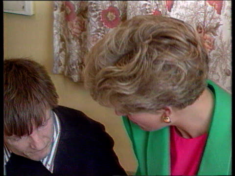 Part 5 SPL0628 Tears Of A Princess Princess Diana with the handicapped Location unknown Diana in green jacket talking to handicapped man as shows him...
