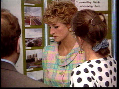 Part 5 T06099211 Princess of Wales visiting marriage guidance charity 'Relate' Princess Diana in pastel shaded suit looking at display and listening