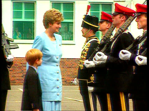 vídeos y material grabado en eventos de stock de part 5 t29079314 princess of wales takes her son harry to visit the army diana in blue suit with prince harry as inspects troops diana signing book - 1993