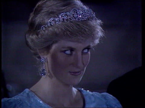 Diana Princess of Wales Collection TX Diana wearing tiara at function Diana wearing silver evening dress and tiara at function Diana signing paper...