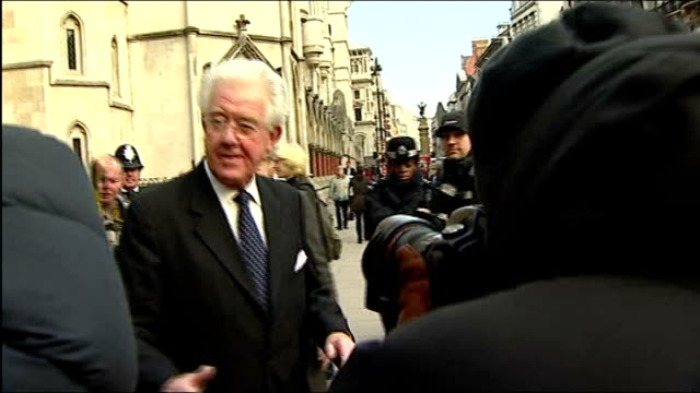 Jury see Diana letters to Duke of Edinburgh ENGLAND London EXT HuntDavis surrounded by press scrum as leaving court