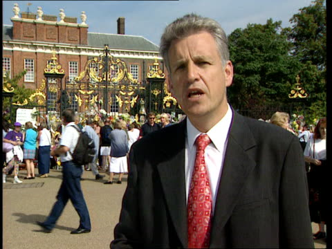 second anniversary of death fltn nicholas owen england london kensington palace ext bv people putting flowers on gates at kensington palace on second... - tribute event stock videos & royalty-free footage