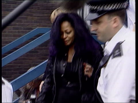 Diana Ross on her Heathrow arrest LIB London EXT GVs Ross escorted by officers from police station