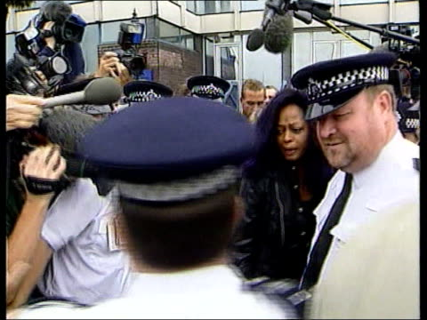 Diana Ross on her Heathrow arrest LIB London Heathrow Airport EXT Ross from police station with police around after receiving caution for assault PAN