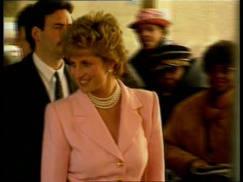 diana visits; diana visits; tx 31.1.95 itn seq princess of wales in baby pink jacket night seq princess of wales with wet-look hair & ankle length... - lunghezza video stock e b–roll