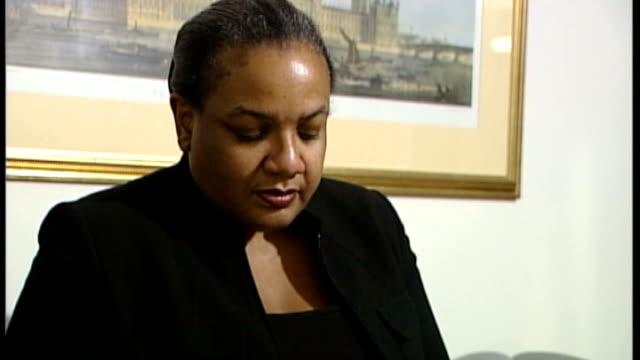 diane abbott criticised for twitter comment about 'white people' t11060736 london int various views of diane abbott flicking through newspaper at... - diane abbott stock videos & royalty-free footage