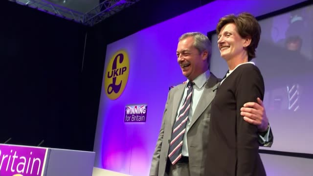 diane james elected new leader of ukip farage and james posing for photocall on stage - diane james politik stock-videos und b-roll-filmmaterial