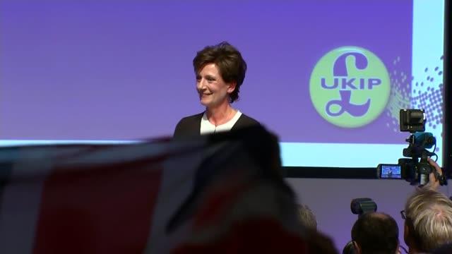 diane james elected new leader of ukip people waving union jacks as diane james on stage - diane james politik stock-videos und b-roll-filmmaterial