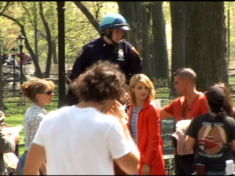 dianna agron and mark salling pet a police horse between takes while shooting a scene for the season finale of 'glee' in central park in new york... - dianna agron stock videos and b-roll footage