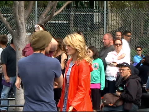 dianna agron chats up a friend in between shooting scenes for the season finale of 'glee' in washington square park in greenwich village in new york... - glee tv show stock videos and b-roll footage