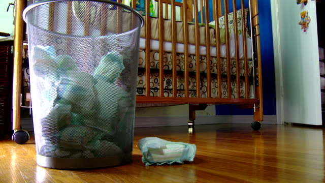 diapers thrown in bin in front of crib - diaper stock videos & royalty-free footage