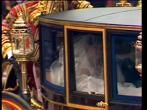 diary of the day: part one; royal wedding: diary of the day: part one; gv bridesmaids wait ditto side diana l-r arrives and stops out of coach and up... - アラステア・バーネット点の映像素材/bロール