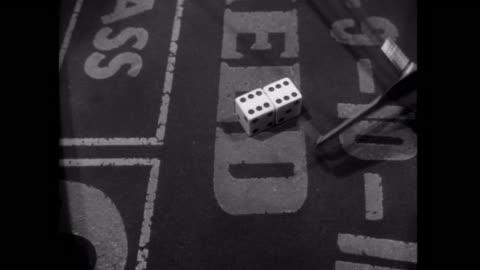 vídeos y material grabado en eventos de stock de 1952 dice are thrown at the craps table - derrota
