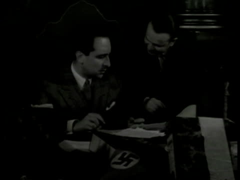dice' committee members in meeting at table talking. map of south america map w/ nazi swastika label. dice' members paperwork books. nazi swastika... - nazi swastika stock videos & royalty-free footage