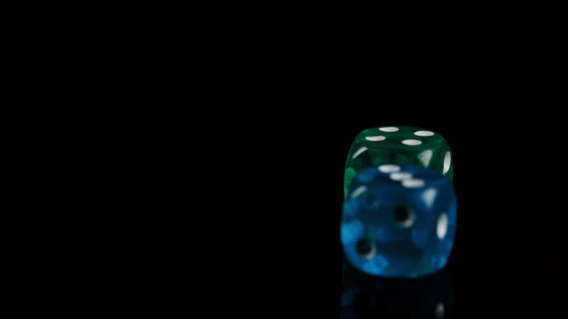 dice fall on black reflective surface - cube stock videos & royalty-free footage