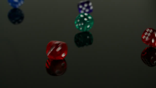 dice fall on reflective surface - cube stock videos & royalty-free footage