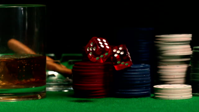 dice falling onto casino table with chips - craps stock videos & royalty-free footage