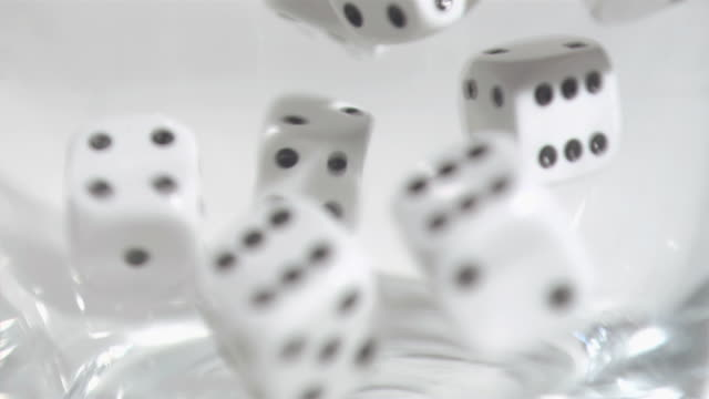 dice in super slow motion being mixed - dice stock videos & royalty-free footage
