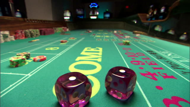 dice on craps table - dice stock videos & royalty-free footage