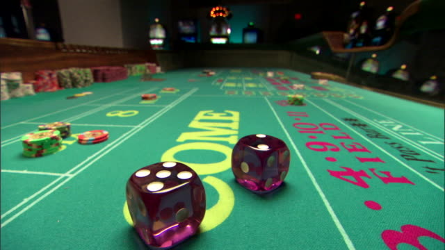 dice on craps table - craps stock videos & royalty-free footage