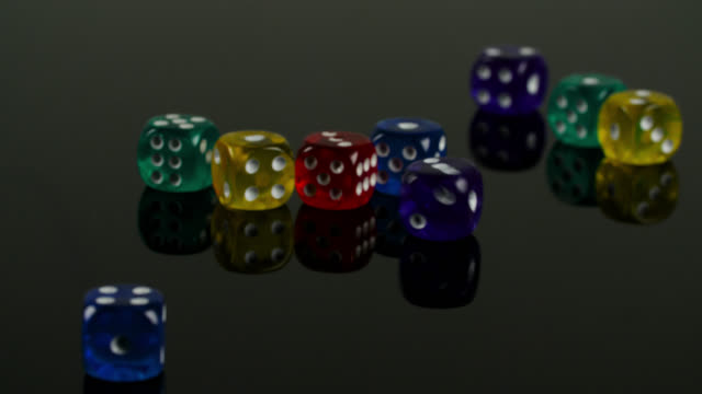 dice on reflective surface - cube stock videos & royalty-free footage