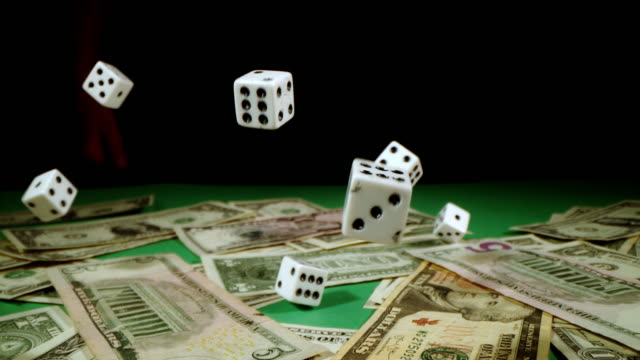 slo mo dices rolling over bunch of dollars - casino winner stock videos & royalty-free footage