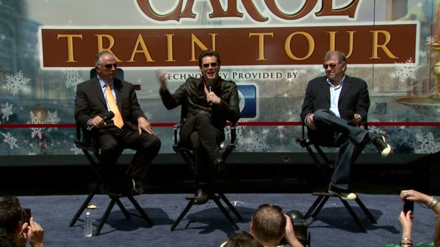 dick cook jim carrey and robert zemeckis on scrooge's transformation at the 'disney's a christmas carol' train tour at los angeles ca - robert zemeckis stock videos and b-roll footage