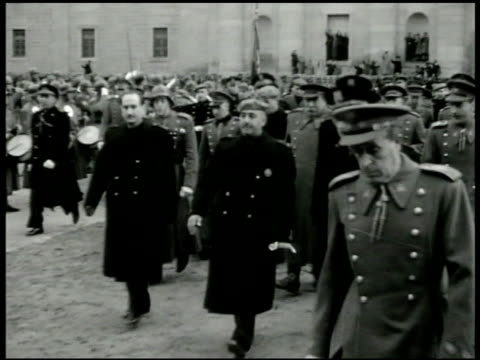 franco dictator generalissimo francisco franco in coat baret hat giving raised arm salute walking in street w/ entourage of officers franco regime... - dictator stock videos & royalty-free footage